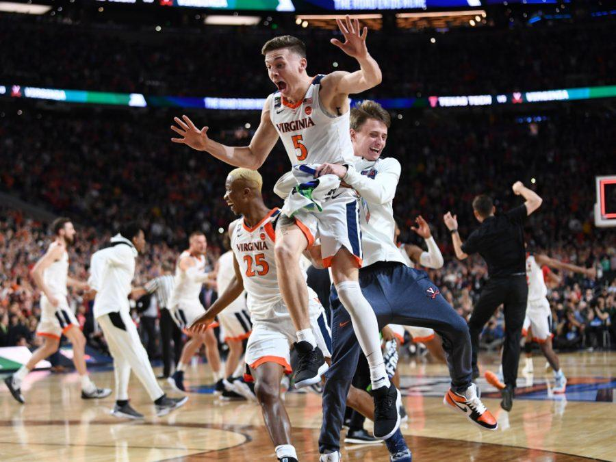 MINNEAPOLIS , MN - APRIL 8: Virginia Cavaliers guard Kyle Guy (5) celebrates after winning The National Championship game at U.S. Bank Stadium.  The Virginia Cavaliers defeated the Texas Tech 85-77 in overtime. (Photo by Jonathan Newton / The Washington Post via Getty Images)