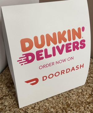 Delivery sign at Dunkin Donuts photographed by Brittany Eldridge.